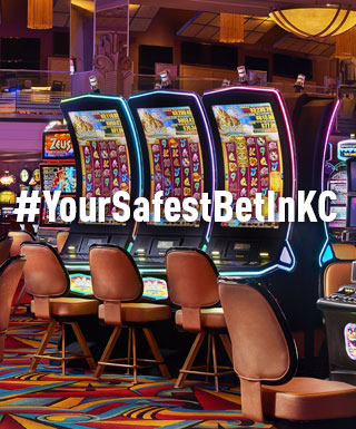 "slot machines at Hollywood Casino at Kansas Speedway with text: ""#YourSafestBetInKC"""